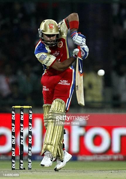 Royal Challengers Bangalore batsmanVirat Kohli plays a shot against Delhi Daredevils in IPL T20 match played at Ferozshah Kotla Ground on May 17 2012...