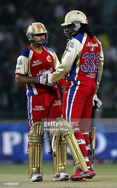 Royal Challengers Bangalore batsmen Chris Gayle and Virat Kohli in action against Delhi Daredevils in IPL T20 match played at Ferozshah Kotla Ground...