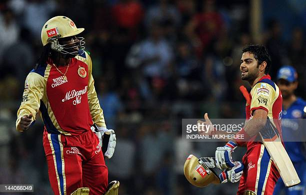 Royal Challengers Bangalore batsmen Chris Gayle and Virat Kohli celebrate after winning the IPL Twenty20 cricket match between Mumbai Indians and...