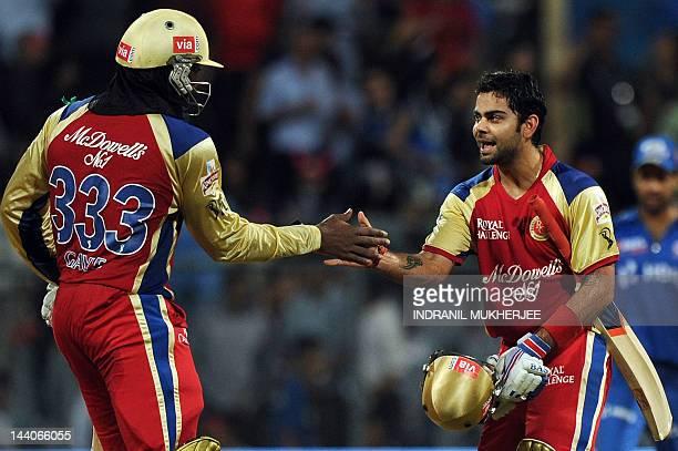 Royal Challengers Bangalore batsmen Chris Gayle and Virat Kohli celebrate after winning the IPL Twenty20 cricket match between Mumbai Indians and...