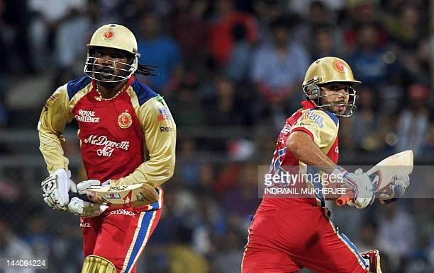 Royal Challengers Bangalore batsmen Chris Gayle and Virat kohli takes a run during the IPL Twenty20 cricket match between Mumbai Indians and Royal...