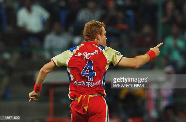 Royal Challengers Bangalore bowler Andrew McDonald celebrates taking the wicket of Kings XI Punjab batsman Shaun Marsh during the IPL Twenty20...