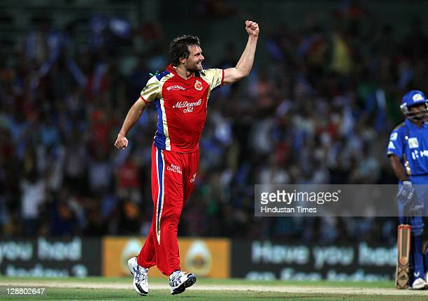 Royal Challengers Bangalore bowler Dirk Nannes pumps his fist in the air after the dissmisal of Mumbai Indians batsman Sarul Kanwar during the...