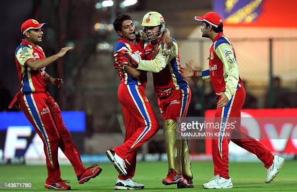 Royal Challengers Bangalore bowler K P Appanna celebrates the leg before wicket dismissal of Kings XI Punjab batsman Mandeep Singh with his team...