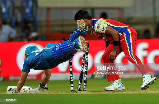 Royal Challengers Bangalore bowler Vinay Kumar stumps Pune Warriors batsman Steven Smith during the IPL Twenty20 cricket match between Royal...
