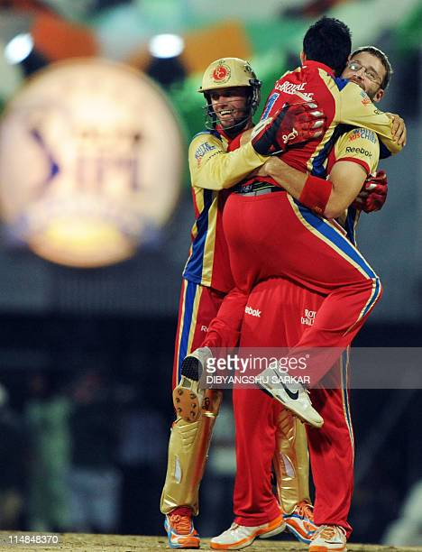 Royal Challengers Bangalore captain Daniel Vettori and teammates Virat Kohli and AB De Villiers celebrate on May 27 2011 after taking the wicket of...