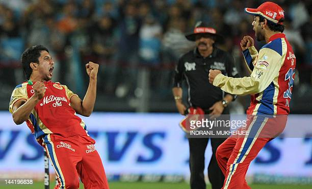 Royal Challengers Bangalore cricketer Kotarangada Appanna celebrates with captain Virat Kohli after taking the wicket of unseen Pune Warriors India...