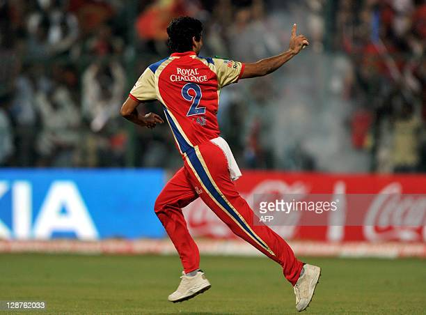 Royal Challengers Bangalore fielder Mohammed Kaif celebrates the dismissal of NSW Blues batsman Shane Watson during the Champions League Twenty20...