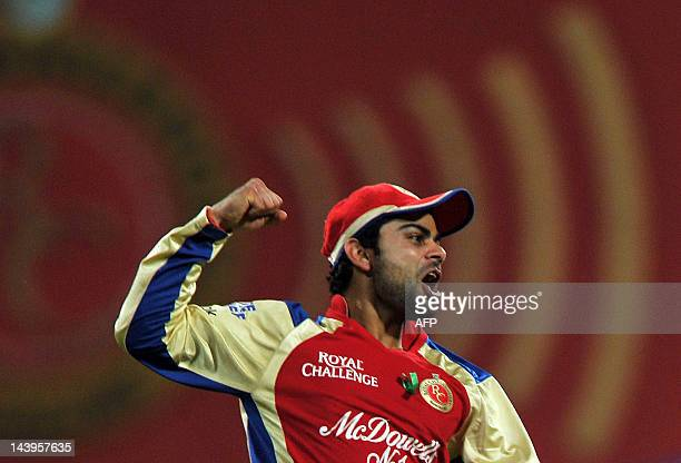 Royal Challengers Bangalore fielder Virat Kholi celebrates the run out of Deccan Chargers batsman Daniel Harris during the IPL Twenty20 cricket match...