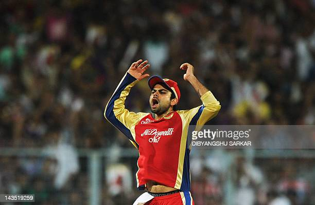 Royal Challengers Bangalore fielder Virat Kohli reacts during the IPL Twenty20 cricket match between Kolkata Knight Riders and Royal Challengers...