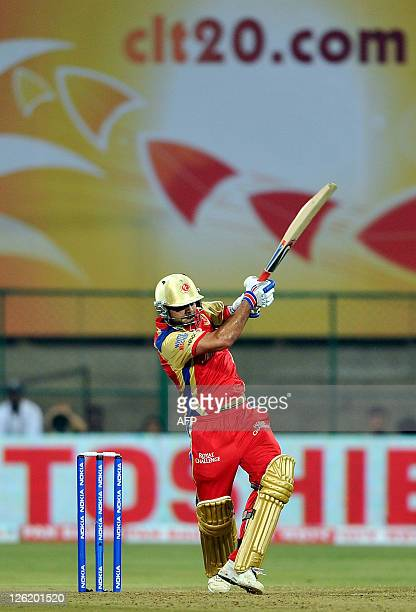 Royal Challengers Bangalore player Virat Kholi plays a shot against the Warrior's during the Champions League Cricket Twenty20 League group B match...