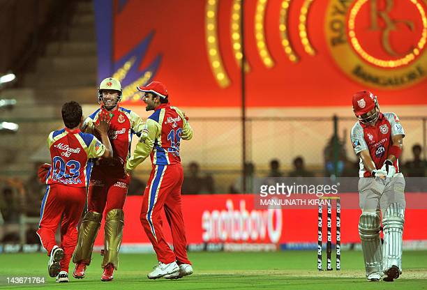 Royal Challengers Bangalore players celebrate the leg before wicket dismissal of Kings XI Punjab batsman Mandeep Singh during the IPL Twenty20...