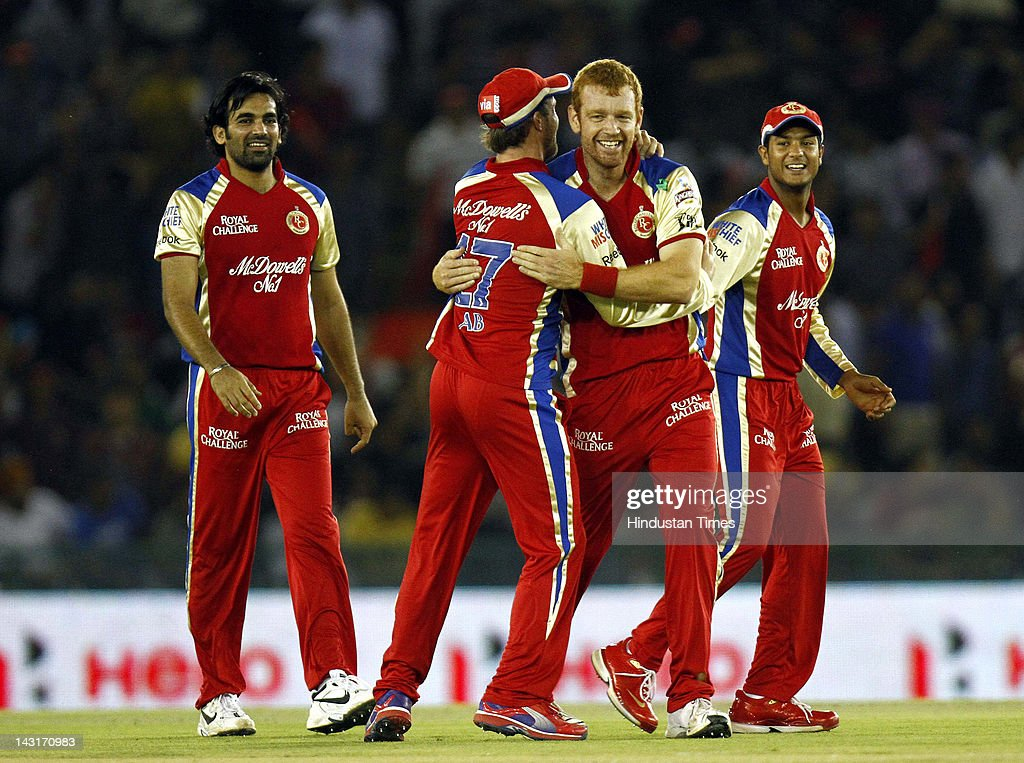 Royal Challengers Banglore Bowler Andrew McDonald (2 R) celebrating the wicket of Kings XI Punjab batsman David Miller during IPL-5 T20 Cricket match played between Kings XI Punjab and Royal Challengers Bangalore at PCA stadium on April 20, 2012 in Mohali, India. Batting first after losing the toss Kings XI Punjab posted a target of 164 runs to win for Royal Challengers Bangalore.