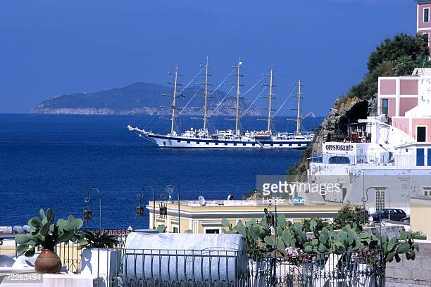 Royal Clipper passing waterfront houses, Italy