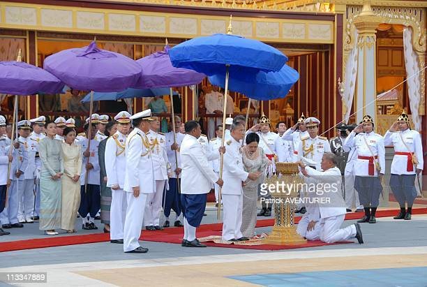 Royal Cremation Of The Princess Galyani Vadhana In Bangkok Thailand On November 15 2008 Thai King Bhumibol Adulyadej and Queen Sirikit lay wood...