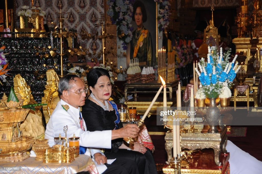 Royal Cremation Of The Princess <a gi-track='captionPersonalityLinkClicked' href=/galleries/search?phrase=Galyani+Vadhana&family=editorial&specificpeople=4783415 ng-click='$event.stopPropagation()'>Galyani Vadhana</a> In Bangkok, Thailand On November 15, 2008 - Thai King Bhumibol Adulyadej and Queen <a gi-track='captionPersonalityLinkClicked' href=/galleries/search?phrase=Sirikit&family=editorial&specificpeople=228360 ng-click='$event.stopPropagation()'>Sirikit</a> lay wood flowers to be placed on the site of cremation during the symbolic royal cremation for the King's late sister Princess <a gi-track='captionPersonalityLinkClicked' href=/galleries/search?phrase=Galyani+Vadhana&family=editorial&specificpeople=4783415 ng-click='$event.stopPropagation()'>Galyani Vadhana</a> at the Royal Crematorium in Bangkok.