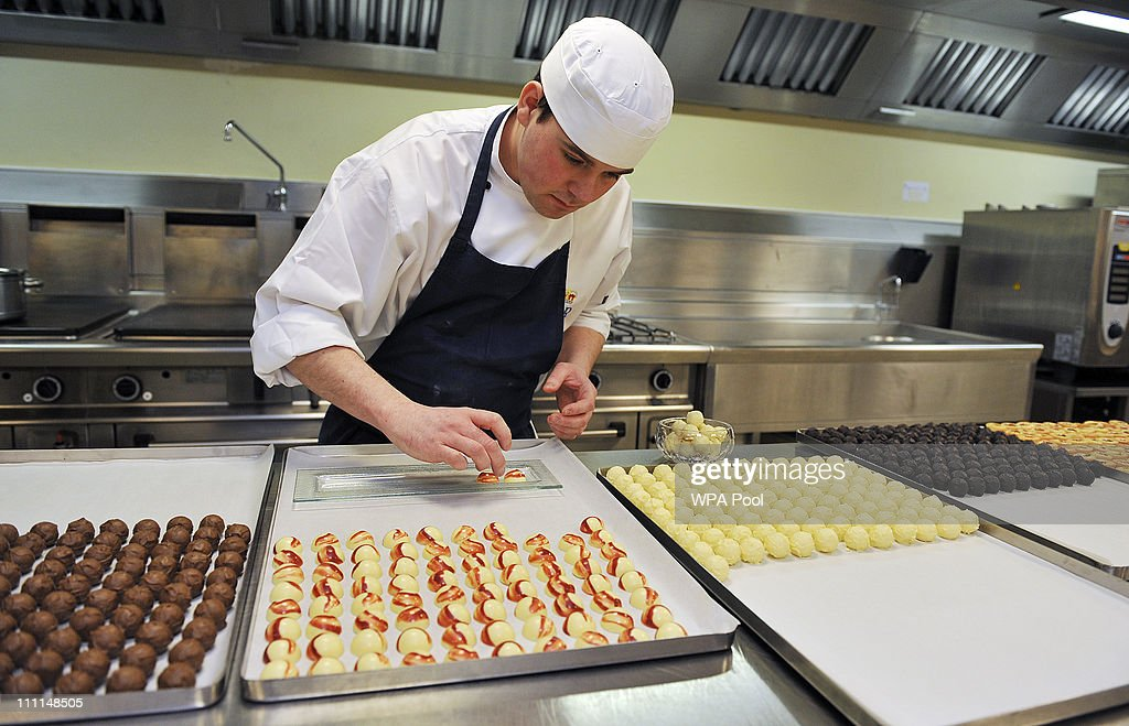 Royal Demi Chef De Partie, Shaun Mason, lays out trays of hand made sweets prepared in the kitchens, akin to that which is usually served at receptions held at Buckingham Palace on March 25, 2011 in London, England. Prince Prince William will marry his long term girlfriend Kate Middleton on April 29, 2011 at Westminster Abbey and it was reported that the couple had chosen two Wedding cakes for their big day - a 'multi-tiered traditional fruit case with a floral design and a chocolate biscuit cake.'