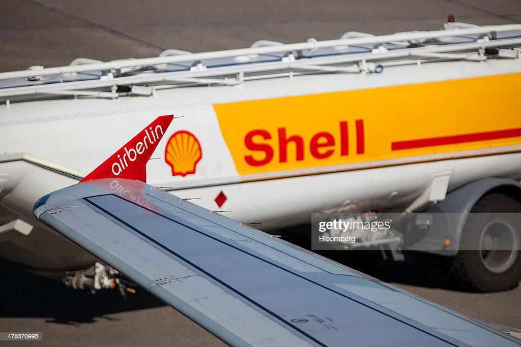 A Royal Dutch Shell Plc fuel truck sits on the tarmac beside an Air Berlin aircraft at Tegel airport, operated by Flughafen Berlin Brandenburg GmbH, in Berlin, Germany, on Wednesday, March 12, 2014. Berlin's Tegel airport has subsisted by chance alone, defying the odds as passenger growth outpaces every other major hub in Western Europe. Photographer: Krisztian Bocsi/Bloomberg via Getty Images