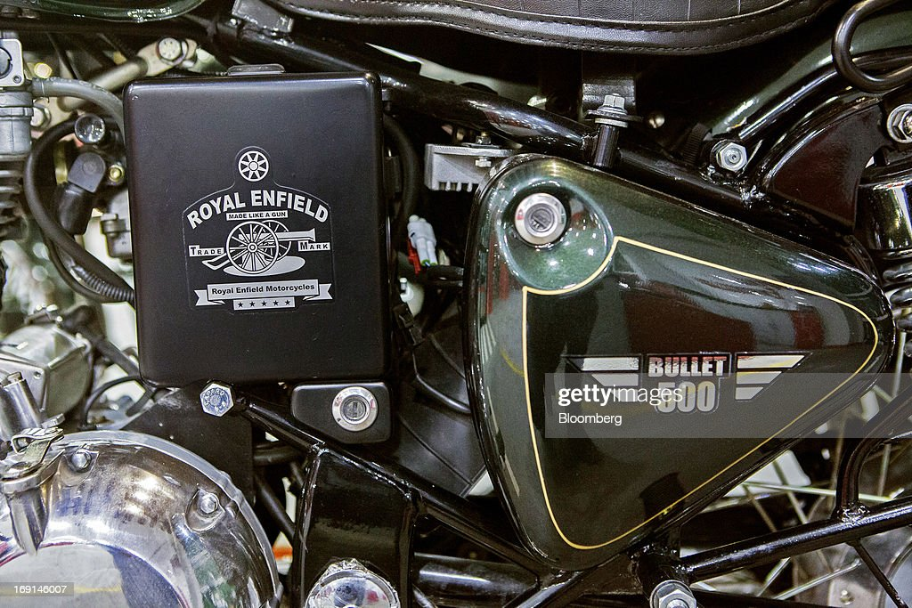 Royal Enfield branding is displayed on the engine block of a Bullet 500 motorcycle on display at the Eicher Motors Ltd. Royal Enfield flagship dealership in Gurgaon, India, on Monday, May 20, 2013. The Indian maker of Royal Enfield, the World War II-era British motorcycle owned by stars including Brad Pitt, plans to export the vehicles to Southeast Asia and Latin America as it builds on record sales at home. Photographer: Prashanth Vishwanathan/Bloomberg via Getty Images