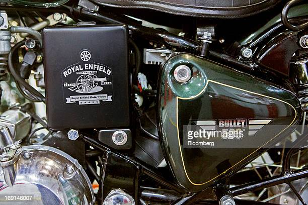 Royal Enfield branding is displayed on the engine block of a Bullet 500 motorcycle on display at the Eicher Motors Ltd Royal Enfield flagship...