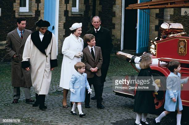 A royal family visit to a museum in Sandringham where the children climb on a fire engine January 1988 From left to right Prince Charles Princess...