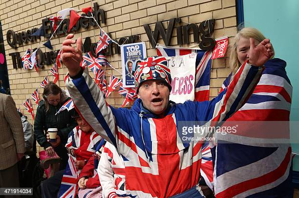 Royal fans celebrate the announcement that Catherine Duchess Of Cambridge has given birth to a baby girl outside the Lindo Wing at St Mary's Hospital...