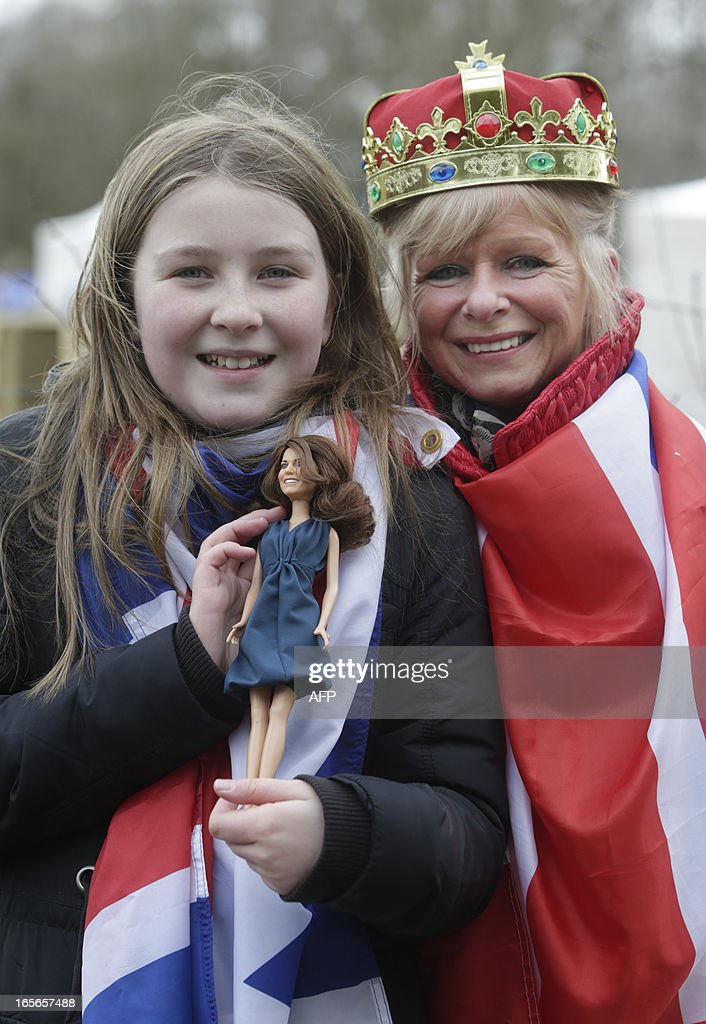 Royal fans Dayna Miller (L) and her mother Sharon Miller (R), hold a doll that they showed to the Duchess of Cambridge, known as the Countess of Strathearn when in Scotland, during her visit to Dumfries House, near Cumnock, south of Glasgow in Scotland on April 5, 2013. The Duke and Duchess of Cambridge braved the bitter cold to attend the opening of an outdoor centre in Scotland. The couple joined the Prince of Wales at Dumfries House in Ayrshire where the Prince of Wales has led a regeneration project since 2007.