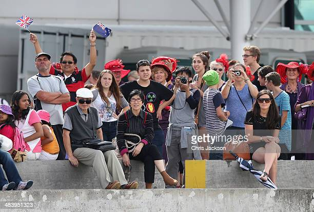 Royal fans wave as Prince William Duke of Cambridge races Catherine Duchess of Cambridge in America's Cup Yachts in Auckland Harbour on April 11 2014...