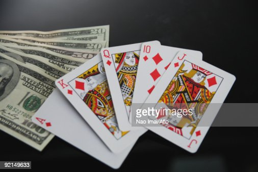 Royal flush in diamond and dollars in studio : Stock-Foto
