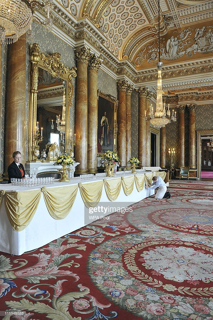 Royal Footmen prepare a drinks table in the Blue Drawing Room, which will be used for the wedding reception of Prince William and Kate Middleton at Buckingham Palace on March 25, 2011 in London, England. Prince Prince William will marry his long term girlfriend Kate Middleton on April 29, 2011 at Westminster Abbey and it was reported that the couple had chosen two Wedding cakes for their big day - a 'multi-tiered traditional fruit case with a floral design and a chocolate biscuit cake.'