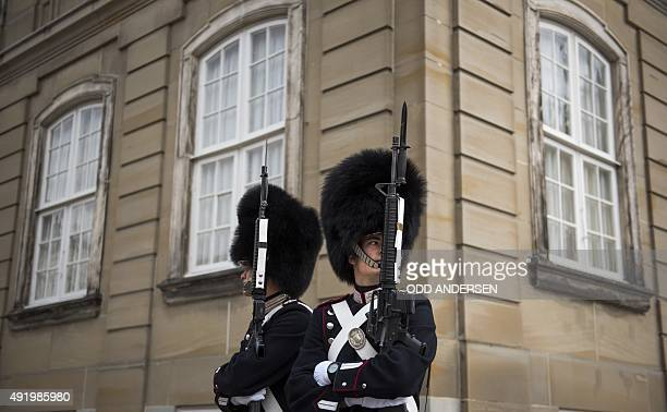 Royal guards are seen outside the Amalienborg palace the winter residence of the Danish Ryal family in Copenhagen on October 9 2015 AFP PHOTO / ODD...