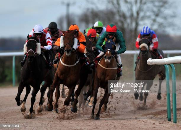 Royal Holiday ridden by Daniel Tudhope leads the pack around the final bend during The Ladbrokes Handicap Stakes with eventual winner Peter's Friend...