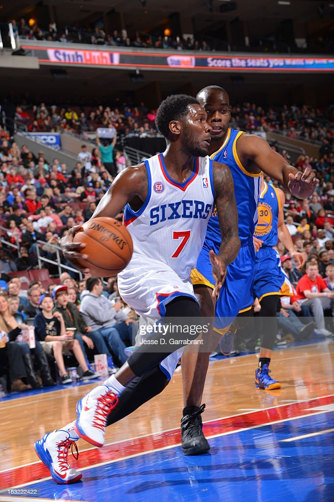 <a gi-track='captionPersonalityLinkClicked' href=/galleries/search?phrase=Royal+Ivey&family=editorial&specificpeople=209331 ng-click='$event.stopPropagation()'>Royal Ivey</a> #7 of the Philadelphia 76ers drives to the basket against the Golden State Warriors on March 2, 2013 at the Wells Fargo Center in Philadelphia, Pennsylvania.