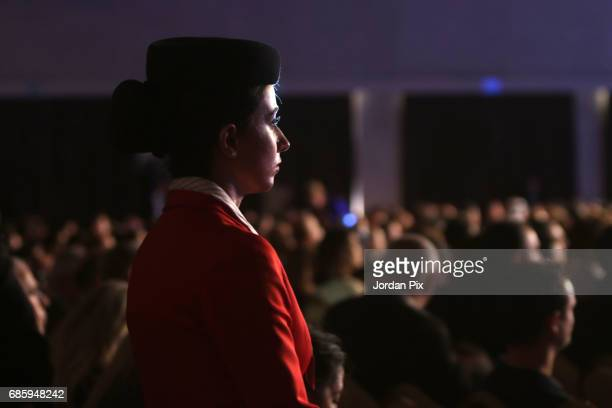 Royal Jordanian airlines hostess stands during the opening session of the World Economic Forum on MENA at the Dead Sea Jordan on May 20 2107