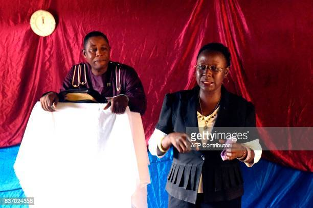 Royal Kings International school director AnnMarie Caulker speaks flanked by pastor Charles O King during a mass celebrated at the school in Freetown...