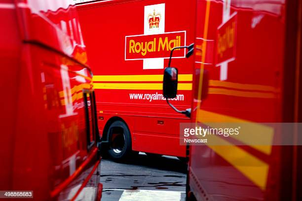 Royal Mail delivery lorries and minivans parked in the car park of the Mount Pleasant Post Office