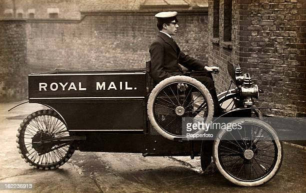 A Royal Mail delivery motor tricycle driven by a postman circa 1910