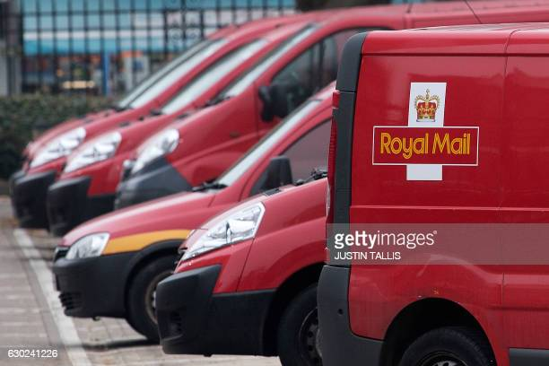 Royal Mail delivery vans are parked at the Mount Pleasant sorting office in London on December 19 2016 / AFP / Justin TALLIS