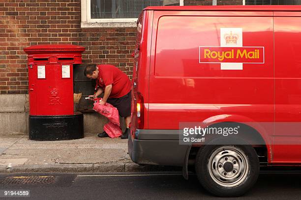 Royal Mail employee empties a post box in Southwark on October 16 2009 in London England The Communication Workers' Union has announced two 24hour...