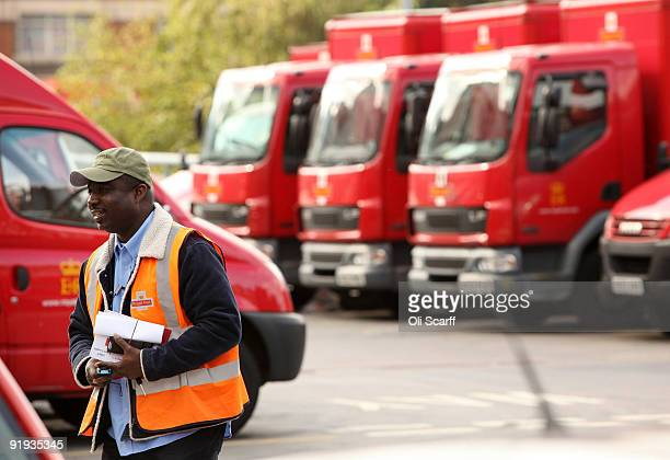 Royal Mail employee walks past vans parked in Mount Pleasant sorting office on October 16 2009 in London England The Communication Workers' Union has...