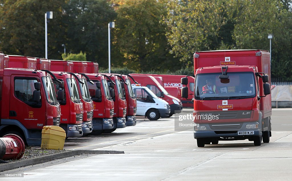 A Royal Mail Group Ltd. delivery truck leaves the company's postal sorting office in Romford, U.K., on Friday, Oct. 11, 2013. Royal Mail Group Ltd., Britain's 360-year-old postal service, jumped as much as 38 percent on its trading debut, heightening criticism of an initial public offering that opposition politicians say was underpriced. Photographer: Chris Ratcliffe/Bloomberg via Getty Images