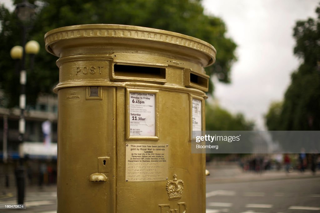 A Royal Mail Group Ltd. double aperture pillar box, painted gold to celebrate the London 2012 Olympic and Paralympic Games, stands in London, U.K., on Thursday, Sept. 12, 2013. Royal Mail Group Ltd., the U.K.'s 360-year-old postal service, intends to hold an initial public offering of a majority stake 'in the coming weeks' to help the company gain a competitive edge against European rivals. Photographer: Matthew Lloyd/Bloomberg via Getty Images