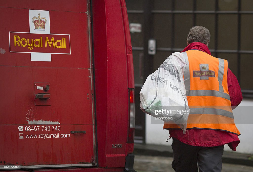 A Royal Mail Group Ltd. employee carries a mail sack towards a postal truck in London, U.K., on Friday, Sept. 13, 2013. Royal Mail Group Ltd., the U.K.'s 360-year-old postal service, intends to hold an initial public offering of a majority stake 'in the coming weeks' to help the company gain a competitive edge against European rivals. Photographer: Simon Dawson/Bloomberg via Getty Images