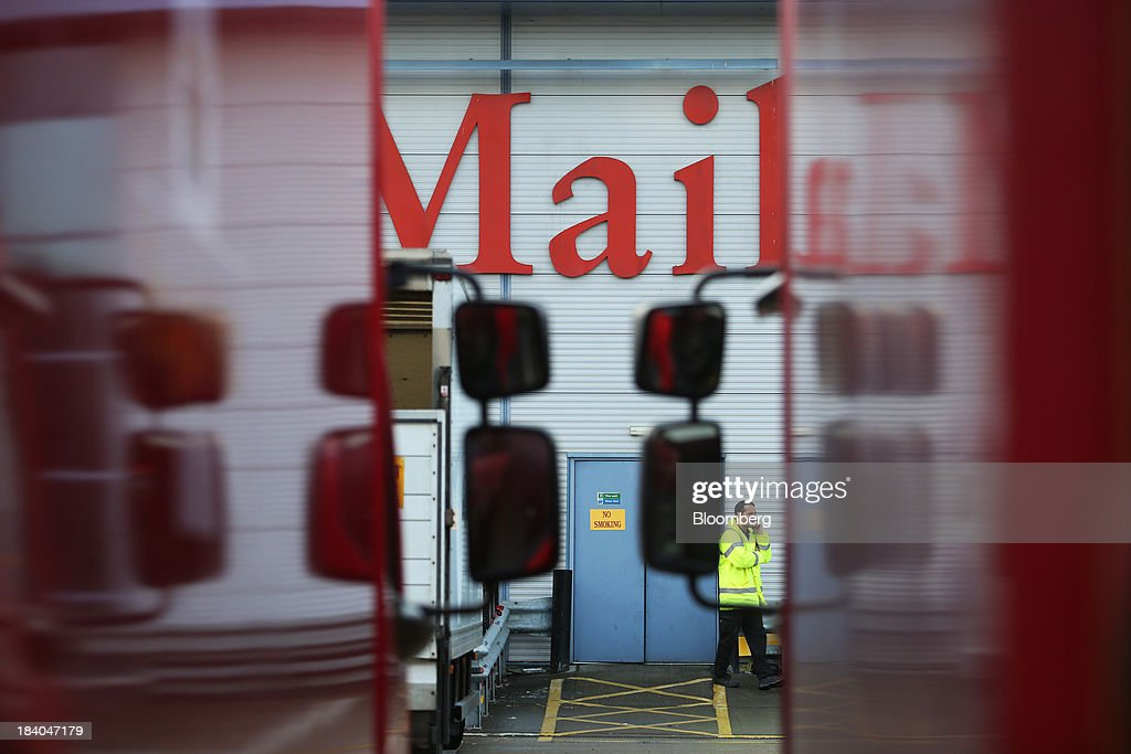 A Royal Mail Group Ltd. employee speaks on a mobile phone at the company's postal sorting office in Romford, U.K., on Friday, Oct. 11, 2013. Royal Mail Group Ltd., Britain's 360-year-old postal service, jumped as much as 38 percent on its trading debut, heightening criticism of an initial public offering that opposition politicians say was underpriced. Photographer: Chris Ratcliffe/Bloomberg via Getty Images