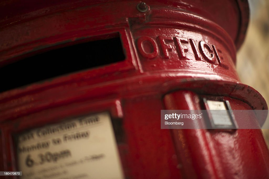 A Royal Mail Group Ltd. pillar box stands in London, U.K., on Thursday, Sept. 12, 2013. Royal Mail Group Ltd., the U.K.'s 360-year-old postal service, intends to hold an initial public offering of a majority stake 'in the coming weeks' to help the company gain a competitive edge against European rivals. Photographer: Matthew Lloyd/Bloomberg via Getty Images