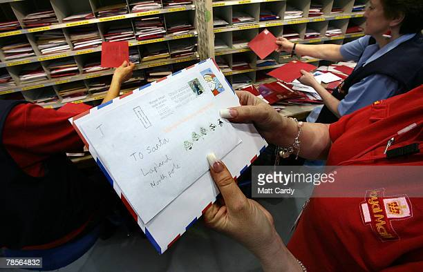 Royal Mail postal worker Carol Jennings sorts Christmas cards address to Santa and Father Christmas in the Royal Mail Regional Sorting Office in...