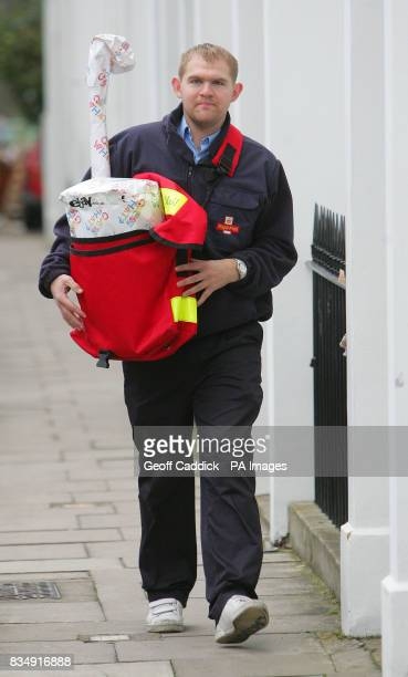 Royal Mail postman Billy Brockwell delivers parcels in Islington London ahead of Sunday December 7 which eBay UK predicts will be the busiest online...