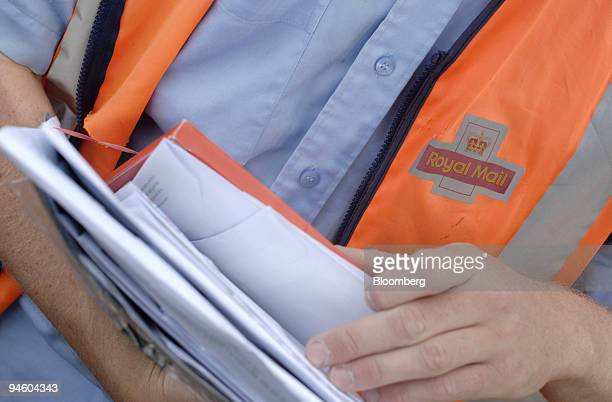 Royal Mail postman delivers mail in the village of Dersingham in Norfolk UK on Thursday June 28 2007 Royal Mail Group Plc the stateowned postal...