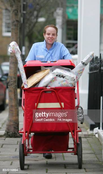 Royal Mail postwoman Kayley Baker delivers parcels in Islington London ahead of Sunday December 7 which eBay UK predicts will be the busiest online...