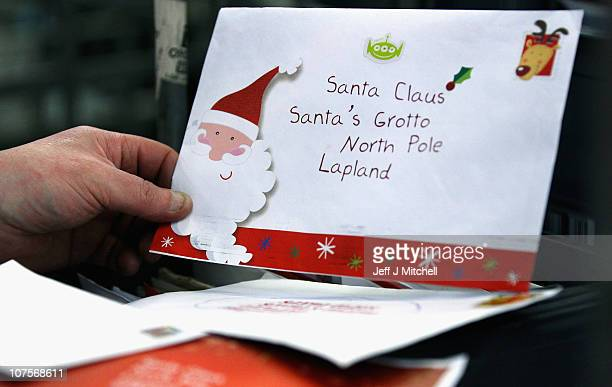 Royal Mail worker displays mail addressed to Santa Claus at the St Rollox sorting office on December 14 2010 in Glasgow Scotland This week is...